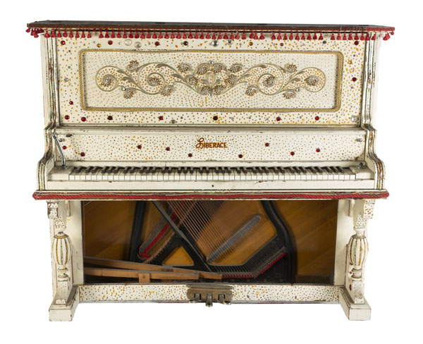 Liberace's ornate red and white Cabinet Grand piano