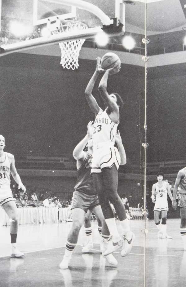 1979 yearbook photo of Obama in his #23 jersey playing basketball