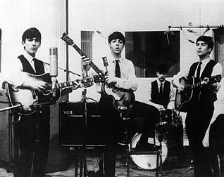 The Beatles in the studio with the guitar