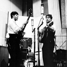 John Lennon in studio with guitar